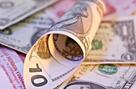人民币兑美元中间价小幅下调 引发市场再度关注